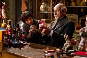 Asa Butterfield as Hugo Cabret and Ben Kingsley as George Melies